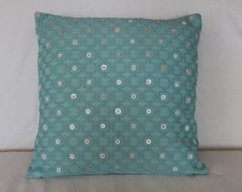 Turquoise circles and buttons pillow cover