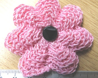 Irish crochet flower brooch in pink with black glass button centre