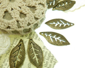 20 antique bronze  leaf charms with open cut work veins  . Size 21 mm x 11 mm