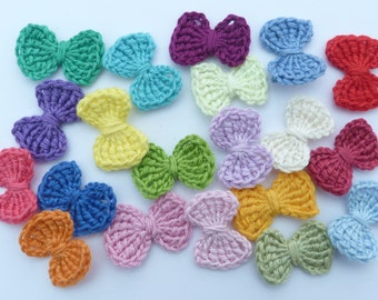20 small crochet bows, appliques and embellishments