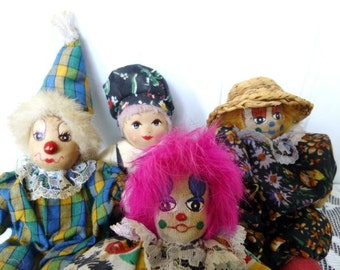 Collection of Three Small Clown Dolls and One Dutch Boy Doll