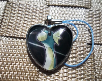 Erika's Dratini Glass Pendant made from Trading Cards