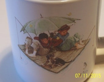 """Norman Rockwell """" Fisherman's Paradise """" Cup"""