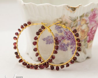 Gold plated hoop earrings wire wrapped with red garnet beads, dark red and golden elegant round hoop style earrings, January birthstone