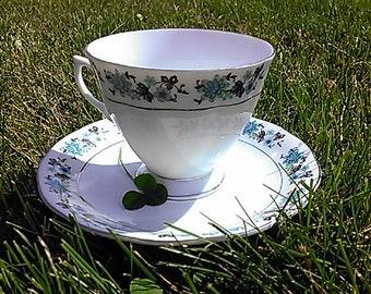 Vintage Blue & Green Flower Rimmed Teacup