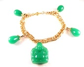 Laughing Buddha Bracelet Molded Glass Jade Green Color Gold Tone Charm