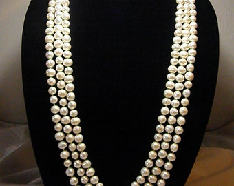 Natural  cultured White Freshwater Pearls.  Three individual, no clasp strands