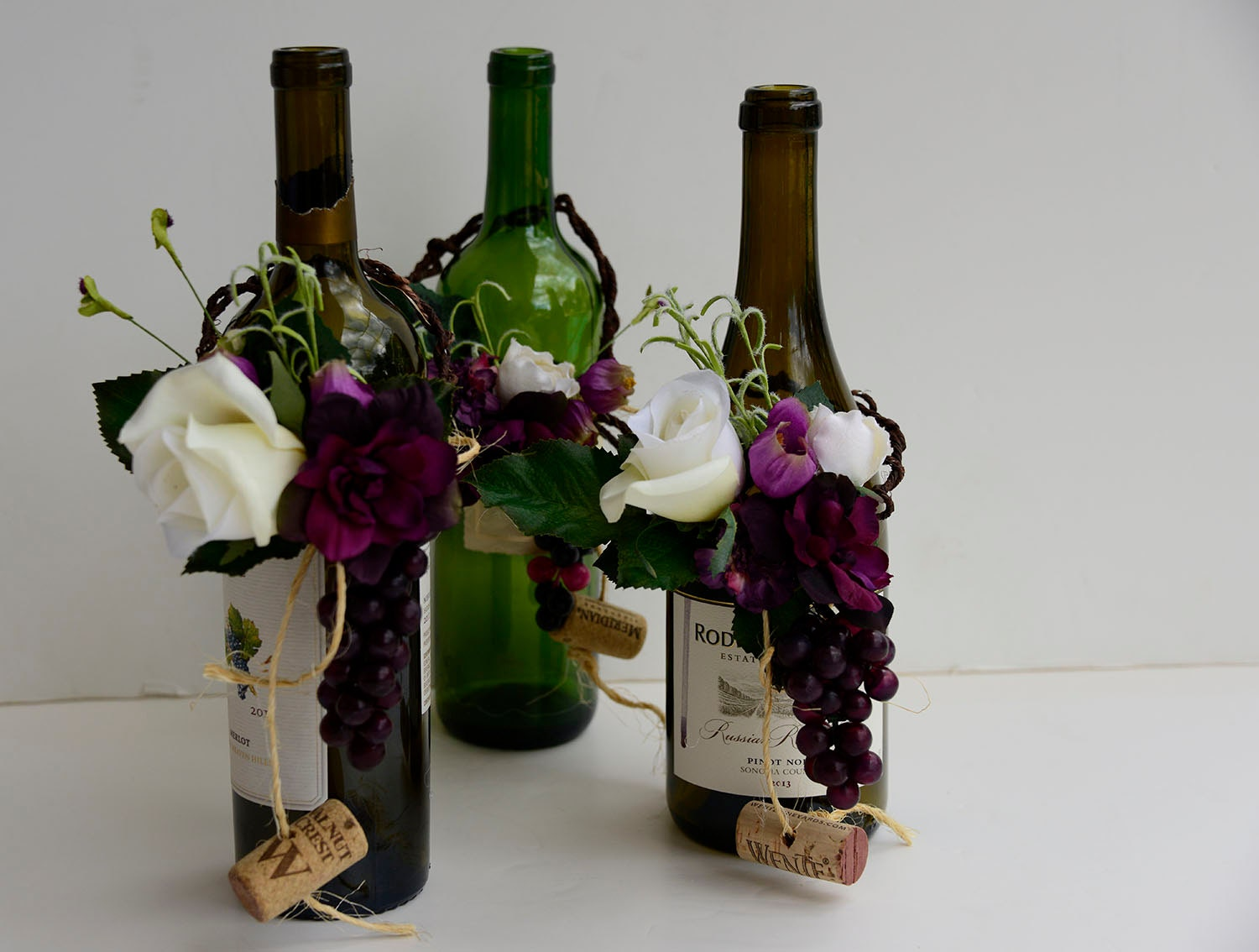 Centerpieces wine theme wedding arrangement and swag with 2 for Wine themed centerpieces