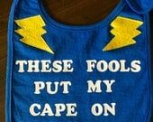 "Unique Baby Bib ""These Fools Put My Cape On Backwards"""