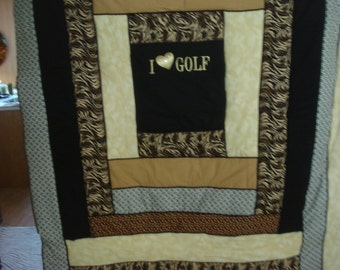 golf-themed flannel blanket in gold and black