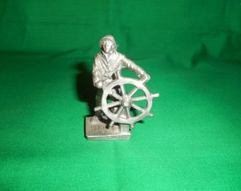One (1). Collectible Pewter Figurine, in the Shape of a Sailor at a Ship Wheel, that's Marked Gallo.