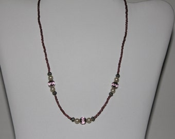 Purple glass beaded necklace with metal beads and foe pearls