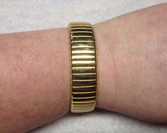 Goldtone Stretch Bracelet, Measures 2 1/2 IncheS in Diameter