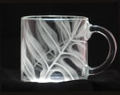 A hand cut and etched clear glass coffee mug with delicately etched Hawaiian Lawaii ferns.