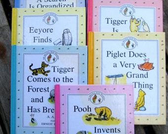 Winnie the Pooh books, set of seven by A.A.Milne, pastel colored covers including Tigger, Piglet, Pooh and Eeyore stories