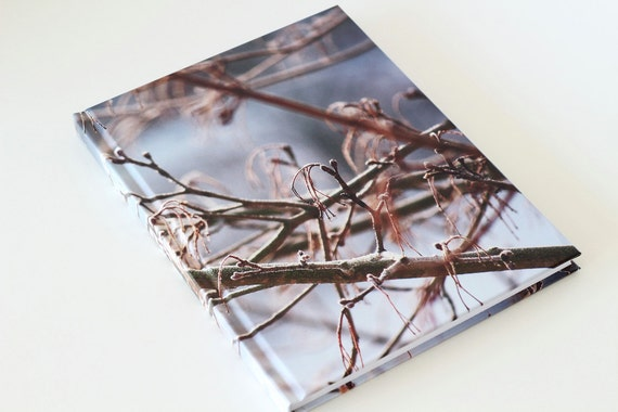 Notebook with photograph of frosted branches going criss-cross on the front cover