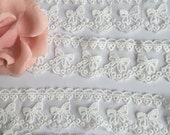 2 yards cute bow embroidered lace ribbon with scalloped edges.  Wedding card.  Skirt dress making.  Curtain making.  Flower girl ribbon.