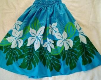 Woman's aqua hula pa'u, hula skirt