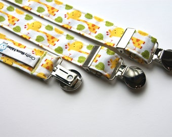 Suspenders - White with yellow giraffes and green leaves.