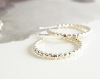 Hammered silver handmade hoops in beaded/dotted wire.