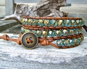 Wrap bracelet with faceted czech glass aqua and golden flake beads on a vintage leather cord