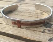 Adjustable aluminum cuff with antique copper cross