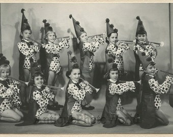 Cute girls theater group in costumes with trumpets antique photo