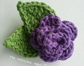 Medium sized purple crochet flower brooch with 2 leaves