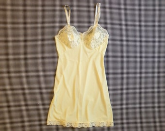 1960's, pale yellow, short, nylon and lace slip, by Gossard Artemis, Women size Small/XS