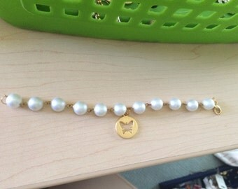 Pearl gold wire wrapped bracelet with gold butterfly charm