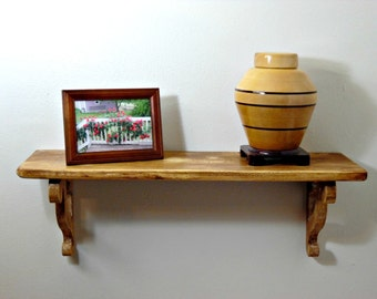 Antiqued Shelf with Scrolled Brackets