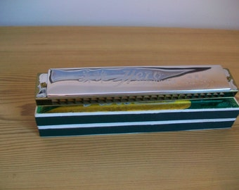 A wooden framed HERO harmonica dating to around late 60s-early 70s in original box; VG condition; music; mouth organ