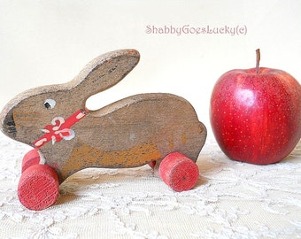 Small vintage pull along toy, wooden rabbit, bunny, hare on wooden wheels, hand painted, old shabby rustic cottage home decoration