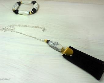 White chain tassel necklace.