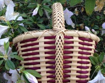 Handwoven Rose Colored Basket with Braided Handle