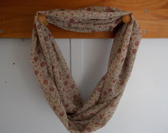 "Infinity Scarf. Tan with flowers and gold sparkels.  Approx 5"" x 72"".  Great light weight scarf to add  to your outfit."