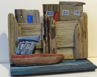 Safe in Harbour is a free-standing picture made of  driftwood and hand painted.