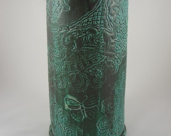Green crock with lace pattern