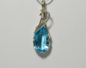 Blue Topaz Wire Wrapped Pendant in Sterling Silver