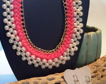 Stunning Pearl and Pink necklace with matching earrings. Great look with a tee shirt, sundress or that lil black dress.