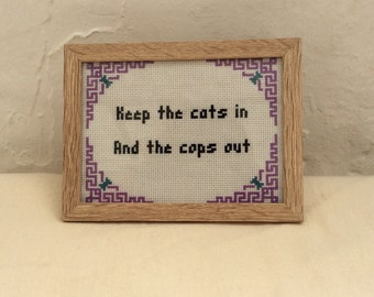 Completed 'Keep the cats in and the cops out' SUBVERSIVE CROSS STITCH