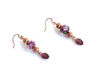 Rose gold plated earrings with purple lamp work beads and crystals