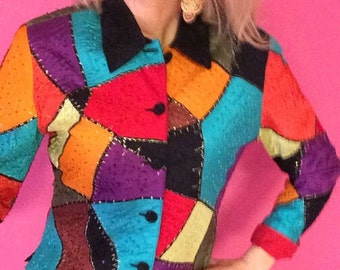 A beautiful vintage jacket by ANAGE fully embellished with multicolored beads in an abstract color block design.