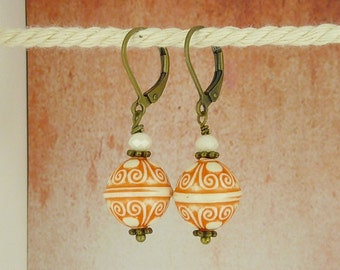 bronze earrings ornament orange and white