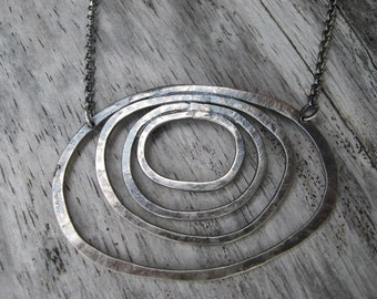 Sterling silver concentric rings necklace by Lisa Colby Metalsmith (N93)