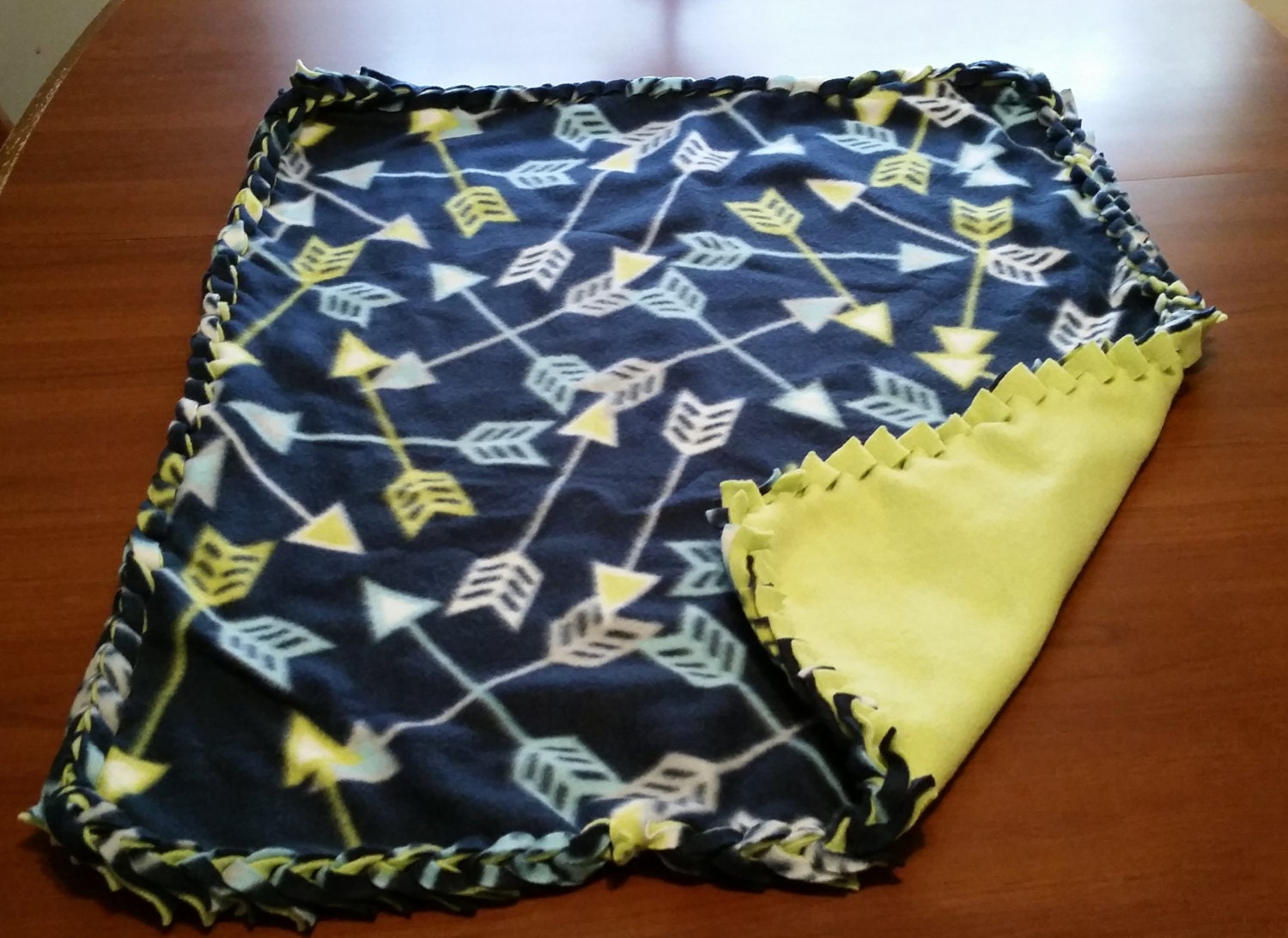 braided fleece blanket arrow pattern by whatthefleeceblanket