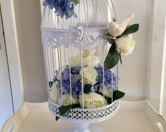 Wedding table centrepiece or church/cake table display.... vintage style birdcage with ivory roses, blue hydrangeas and ivory peonies