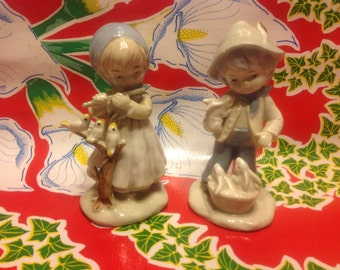 Vintage pair of hand painted porcelain figurines- peasant girl and boy