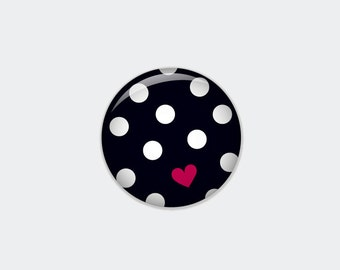 Dotted button in black with white dots