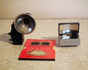 Two Vintage Kodak Flash Units and a Philips Exposure Guide